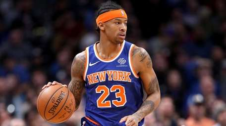 Trey Burke of the Knicks brings the ball
