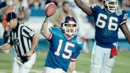 Giants quarterback Jeff Hostetler runs from the field