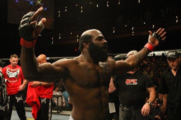 Kimbo Slice celebrates after winning a unanimous decision
