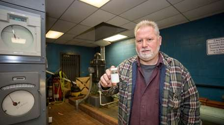 Michael Colangelo, Glen Cove's water service foreman, holds