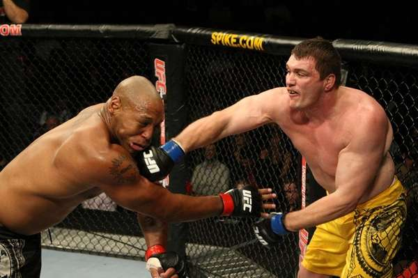 Matt Mitrione, right, connects with a right hand