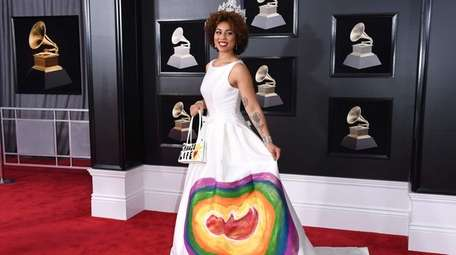 Joy Villa wore a white gown with a