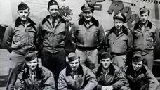 World War II pilot Norman Landberg, center, with