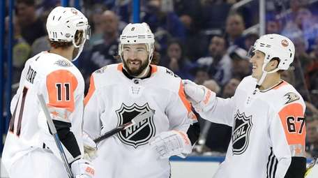 Pacific Division's Drew Doughty, center, of the Los