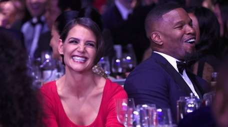 Tight-lipped actors Katie Holmes and Jamie Foxx laugh