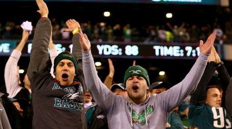 Philadelphia Eagles fans celebrate the win over the