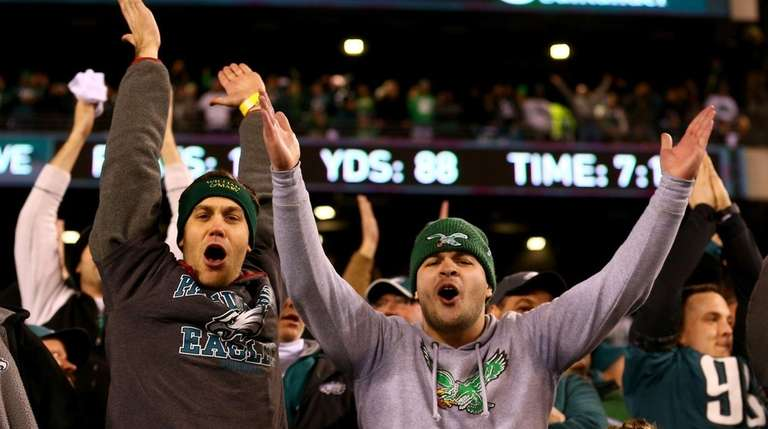 Philadelphia Eagles fans celebrate the win over the