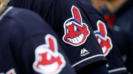 Members of the Indians wear uniforms featuring mascot