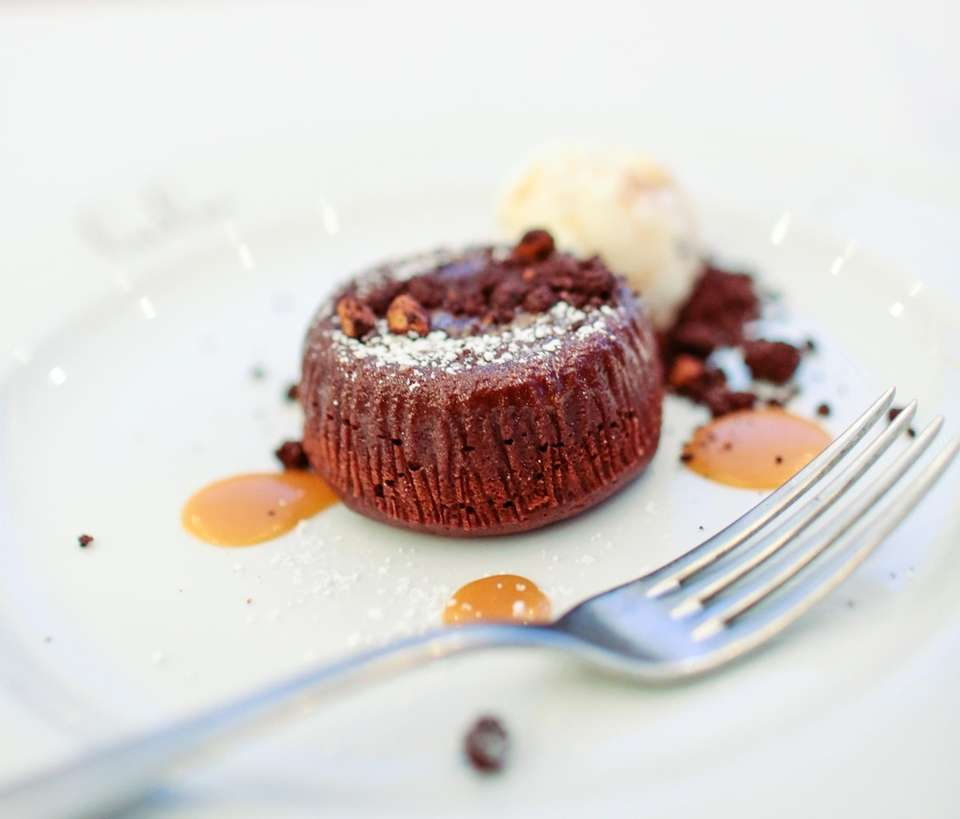 Chocolate caramel molten cake is served with chocolate