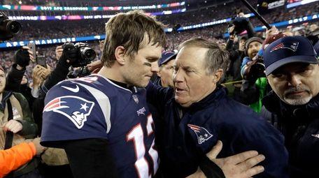 New England Patriots quarterback Tom Brady, left, hugs