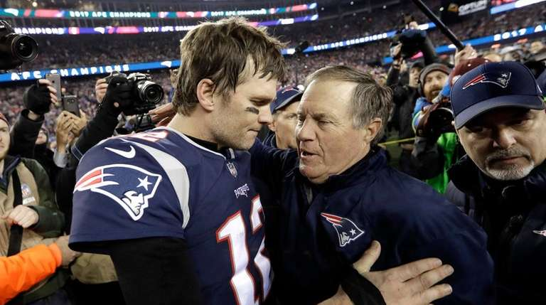 New England Patriots quarterback Tom Brady, left, hugs