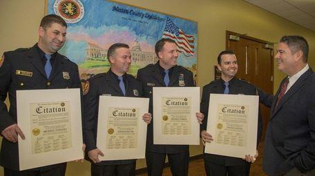 From left, Nassau police officers Michael Vergano, Edward