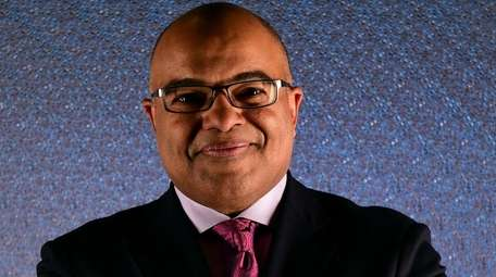 NBC Sports broadcaster Mike Tirico poses for a