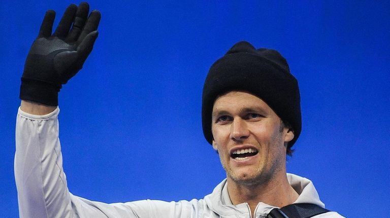 Patriots quarterback Tom Brady waves as he