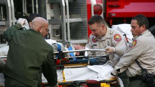 Emergency workers free a Mario Flores from a