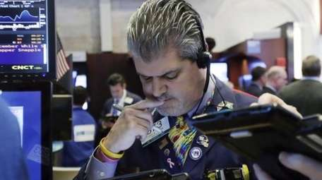 Trader John Panin works at the NYSE, Monday,