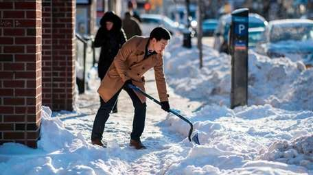 Shoveling snow after a storm falls on tenants