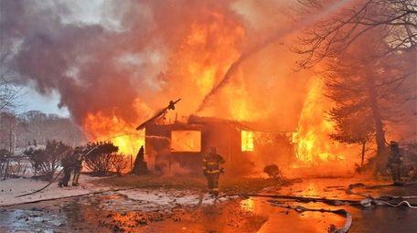 Firefighters work on a fire in an empty