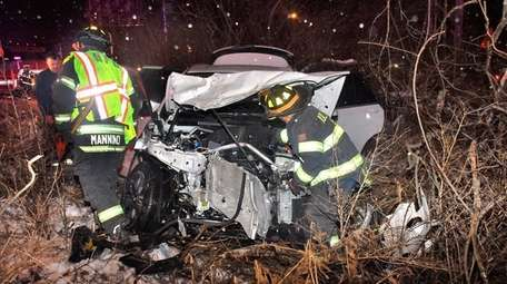 Firefighters respond to a crash Tuesday, Jan. 30,