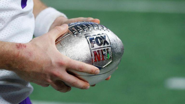 Vikings quarterback Case Keenum holds the Fox NFL