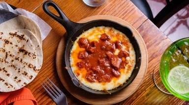 Molten queso fundido with chorizo comes with warm