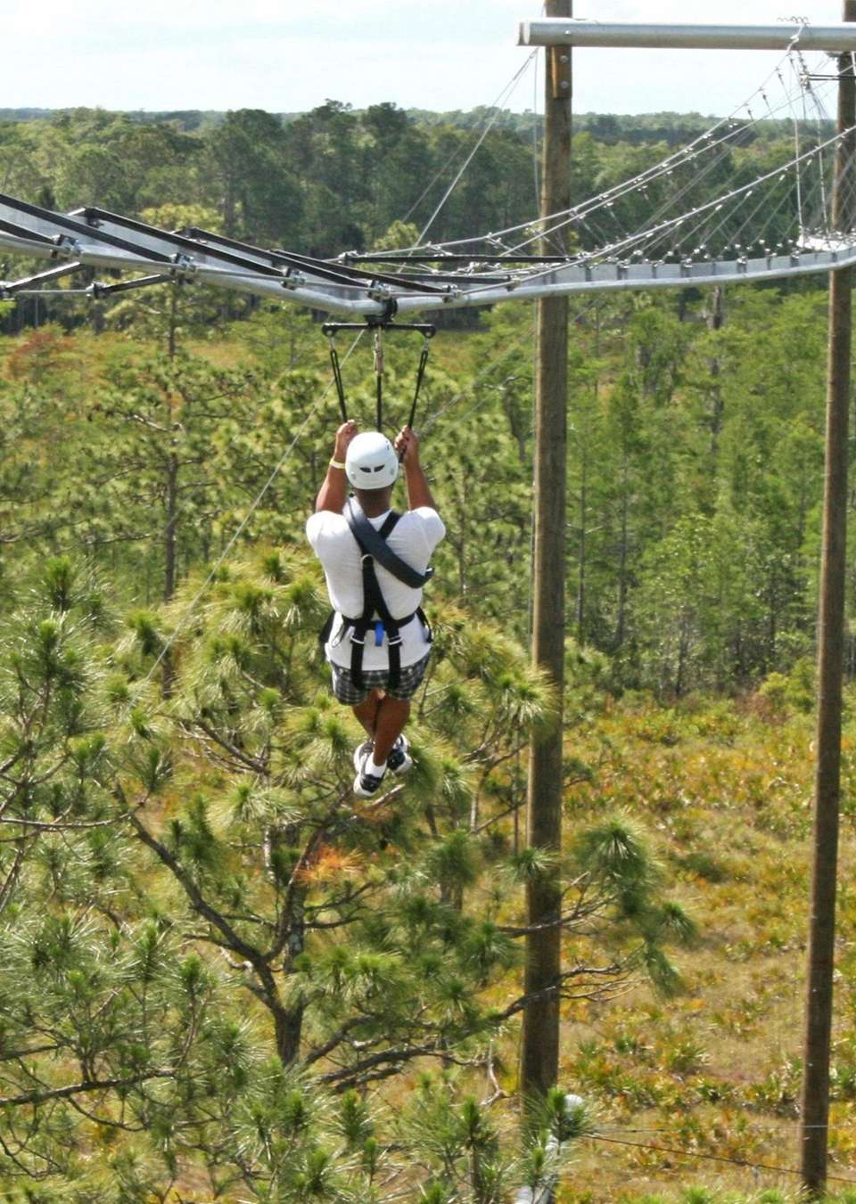 A first-time zip-line rider takes off on the