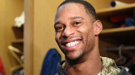Victor Cruz answers questions from the media in