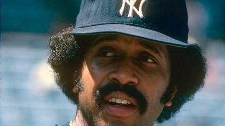 Oscar Gamble of the Yankees looks on prior