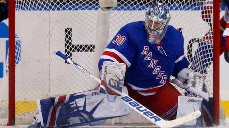 Henrik Lundqvist of the Rangers defends the net