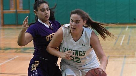 Jaclyn Grzelaczyk of Seaford drives the ball against