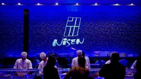 The blue-light enveloped sushi bar at Nisen Sushi