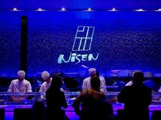 The blue-light enveloped sushi bar at Nisen Sushi