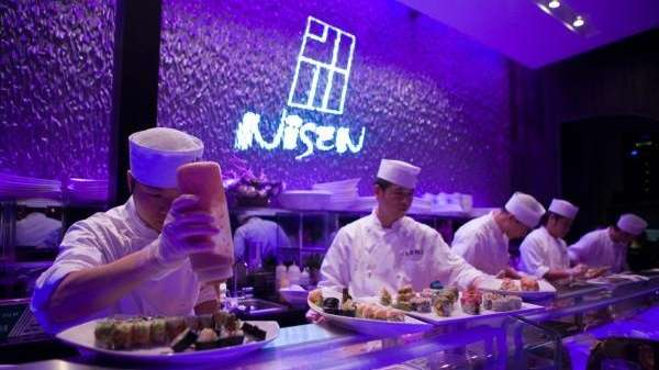 Chefs Prepare Sushi And Rolls At Nisen