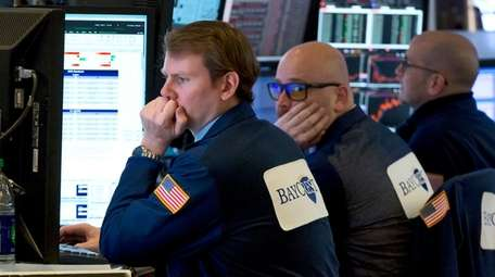 A trio of traders work in a booth