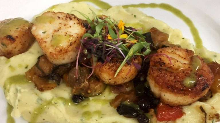 Seared scallops over truffle mashed potatoes and lemon-herb