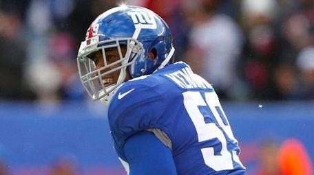 Giants linebacker Devon Kennard reacts after a play