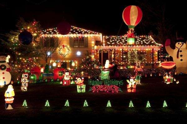 Holiday decorations light up the front yard of