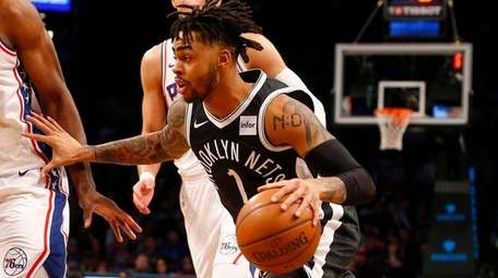 D'Angelo Russell of the Nets drives to the