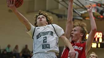 Westhampton Beach's Jacob Gaudiello #2 goes up for