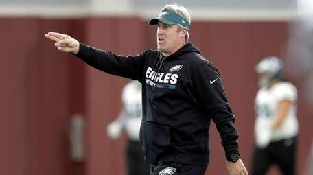 Eagles head coach Doug Pederson gives directions during