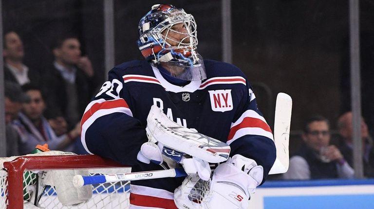 New York Rangers goaltender Henrik Lundqvist looks on