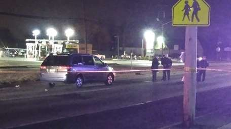 A woman crossing a Hicksville road suffered serious