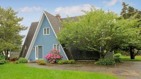 The A-frame construction gives this Hampton Bays home