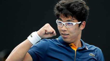 South Korea's Hyeon Chung celebrates after defeating Germany's