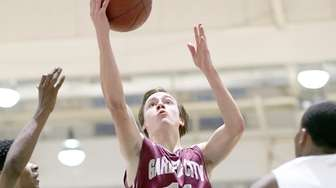 Garden City's Matt Granville goes to the hoop