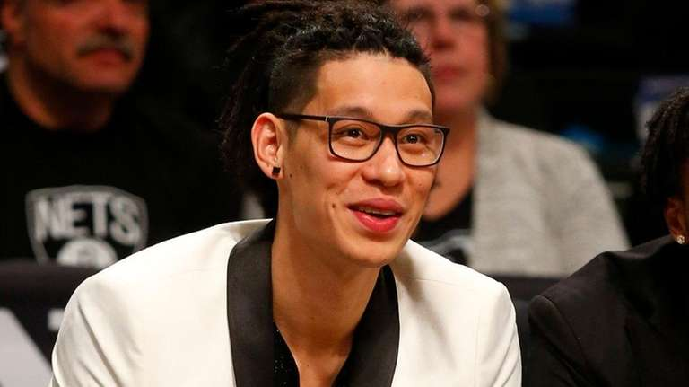 Jeremy Lin of the Nets looks on from