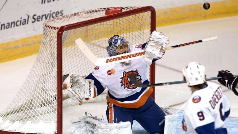 Rick DiPietro deflects a shot on goal against