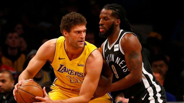 Brook Lopez of theLakers works against DeMarre Carroll