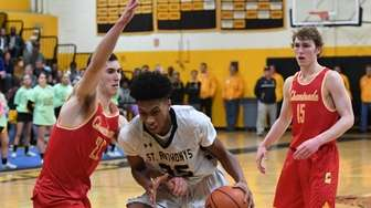 St. AnthonyÕs forward Tyrone Lyons Jr. drives to