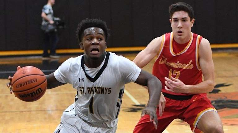 St. Anthony's guard Jonathan Harewood drives the ball
